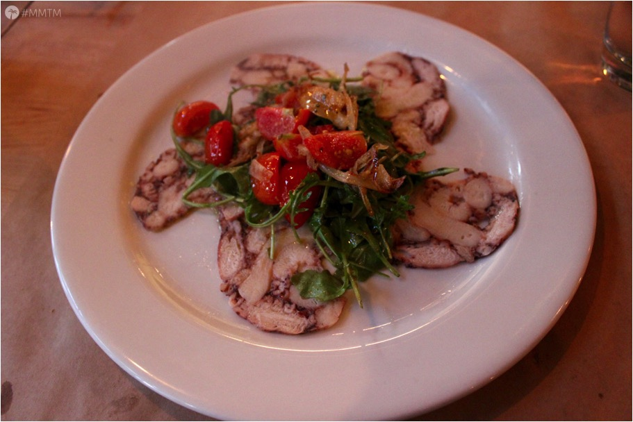 Octopus Carpaccio with sauteed cherry tomatoes and passionfruit vinaigrette