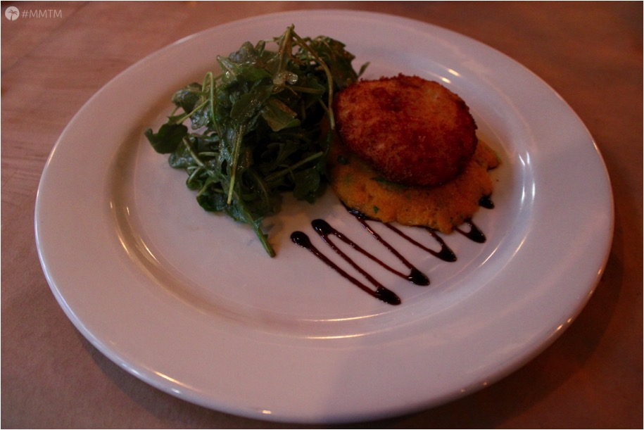 Fried Goat Cheese Medallion atop a pumpkin puree, arugula and truffle oil