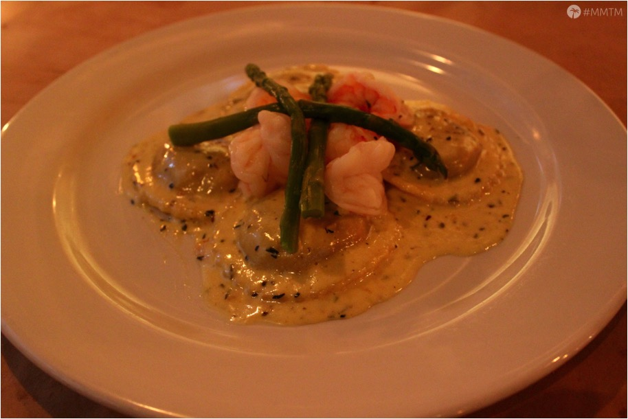 Short Rib Ravioli with Four Cheese Sauce topped with poached shrimp and asparagus